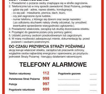 tablica z numerami alarmowymi